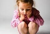 Kind mit der Waage