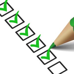 Checklist With Green Checkmark Icon
