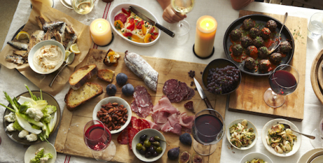 Italian antipasto on linen covered table.